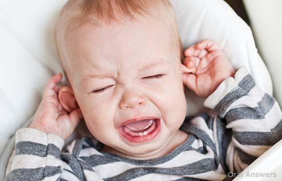 04 baby-teething-ear-pulling
