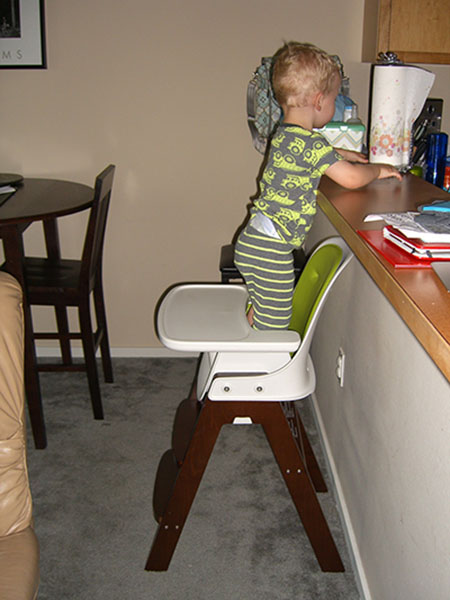 baby-boy-standing-high-chair